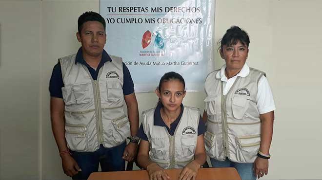 Carlos Rodr�guez, Carmen V�squez y Gladys Pupiales, directivo de la Asociaci�n Martha Guti�rrez.
